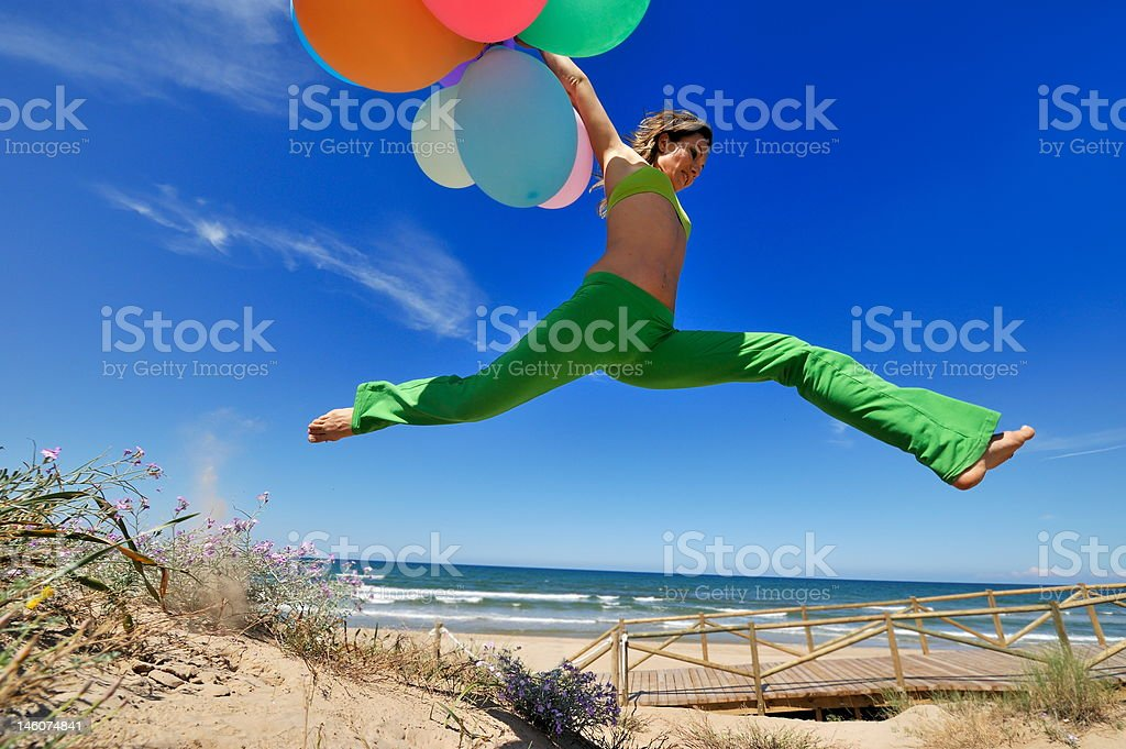 girl jumping on the beach royalty-free stock photo