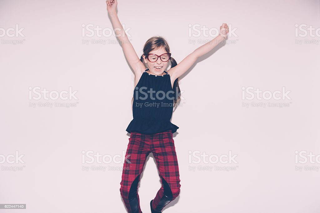 Girl Jumping On The Bed stock photo