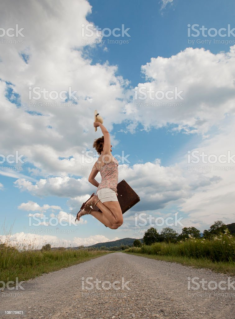Girl jumping on the road stock photo