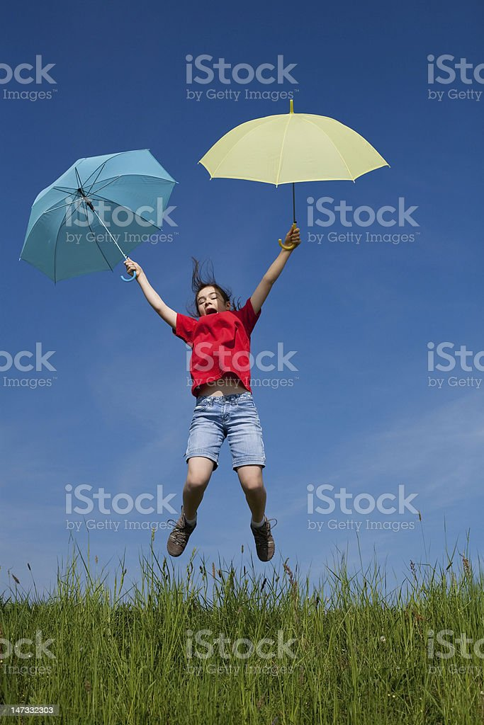Girl jumping outdoor stock photo