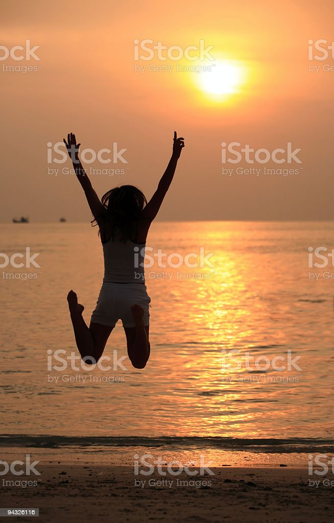 Girl jumping outdoor. stock photo