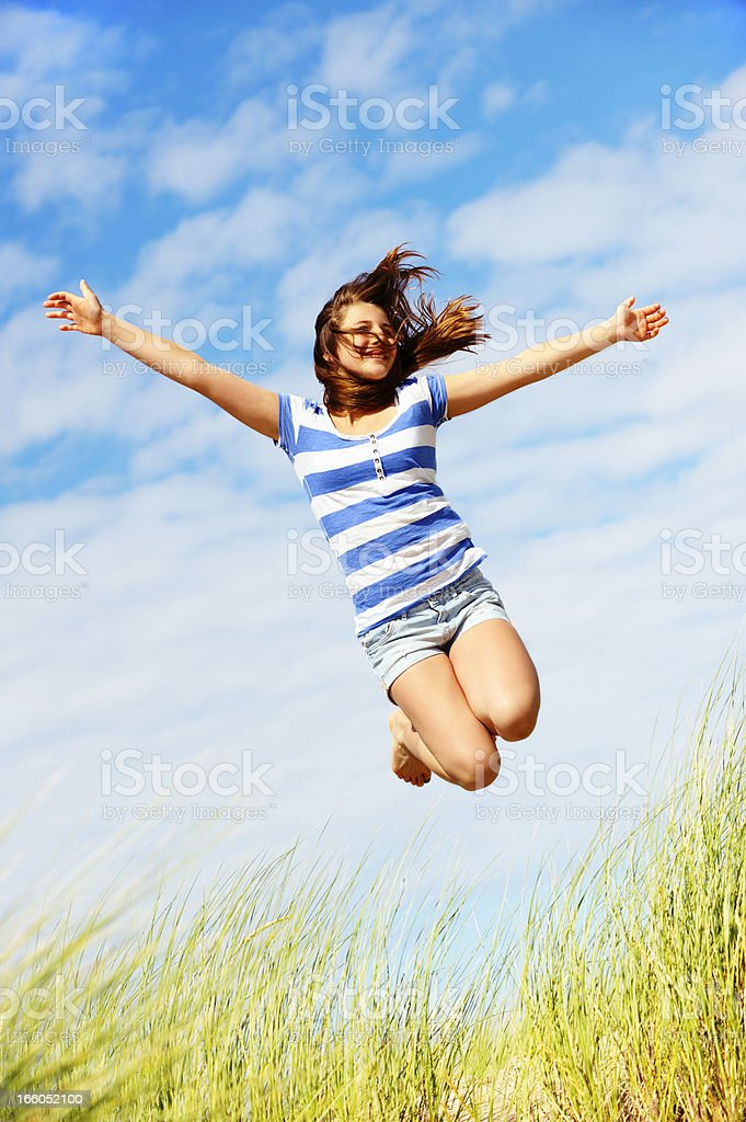 Girl Jumping over the Dunes royalty-free stock photo