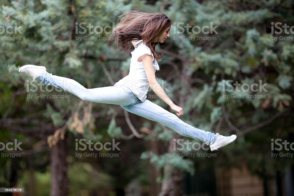 girl jumping splits royalty-free stock photo