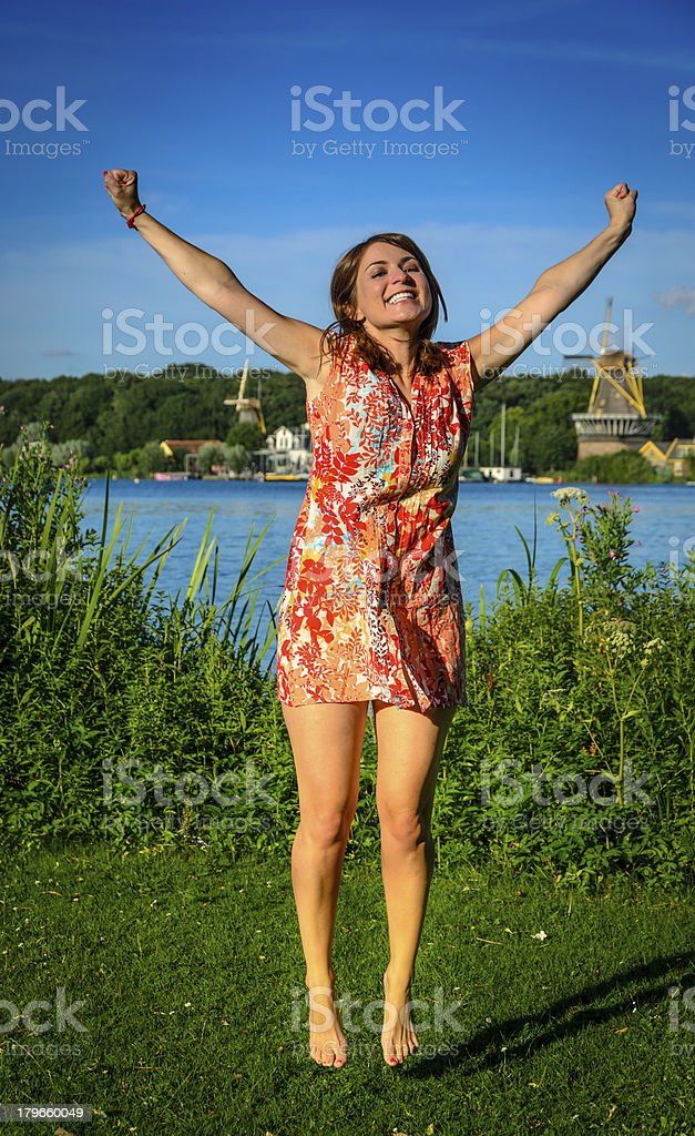 Girl jumping with joy royalty-free stock photo