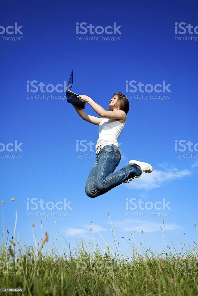 girl jumping with laptop royalty-free stock photo
