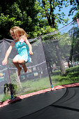 girl jumps on the trampoline