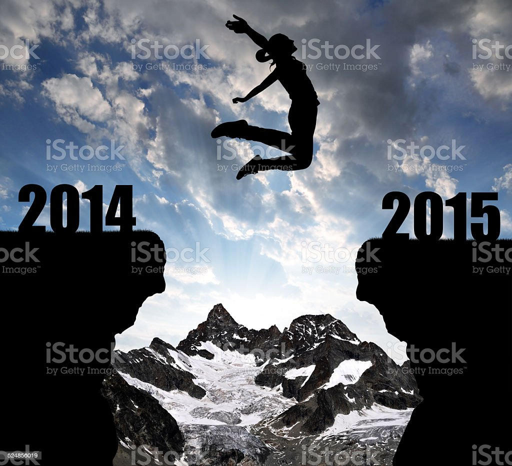 Girl jumps to the New Year 2015 stock photo