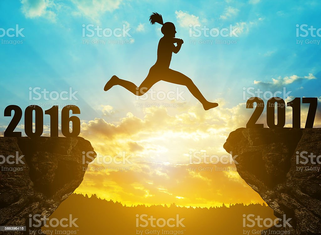 Girl jumps to the New Year 2017 stock photo