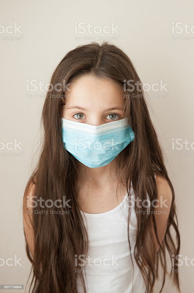 girl kid epidemic flu medicine child  medical mask stock photo