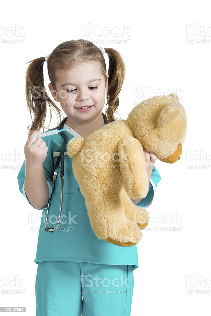 girl kid playing a doctor with syringe in hand stock photo