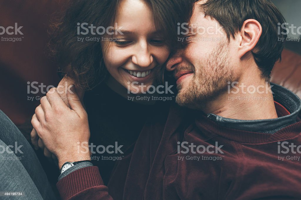 Girl kiss her boyfriend from above stock photo
