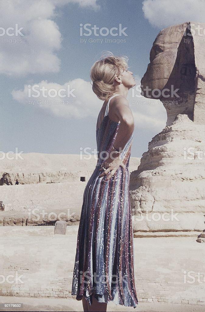Girl kiss the sphinx stock photo