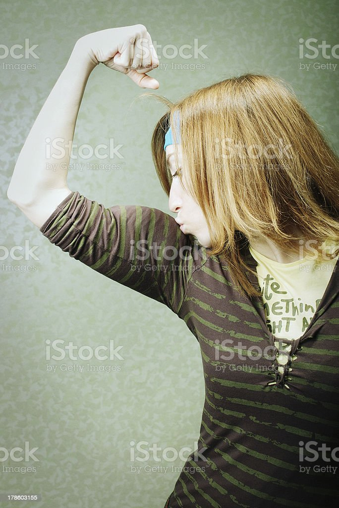 girl kissing her biceps royalty-free stock photo