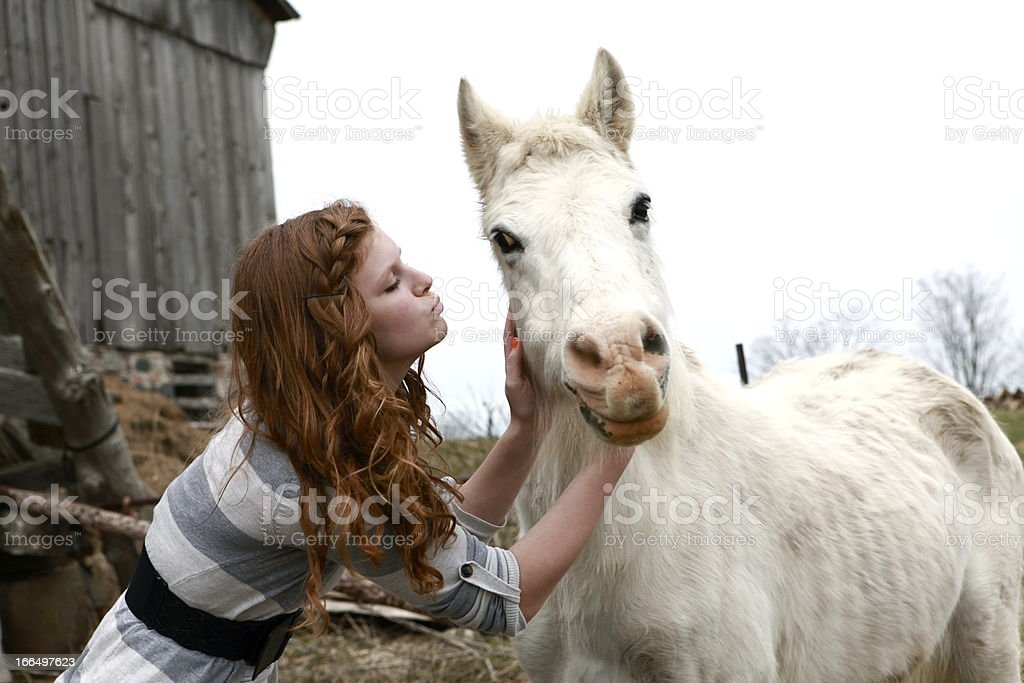Girl Kissing Horse royalty-free stock photo