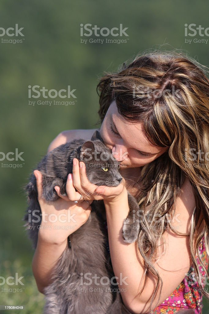 Girl kissing the cat royalty-free stock photo