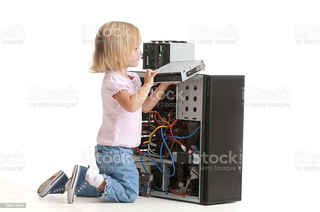 Girl kneels beside an open PC. royalty-free stock photo
