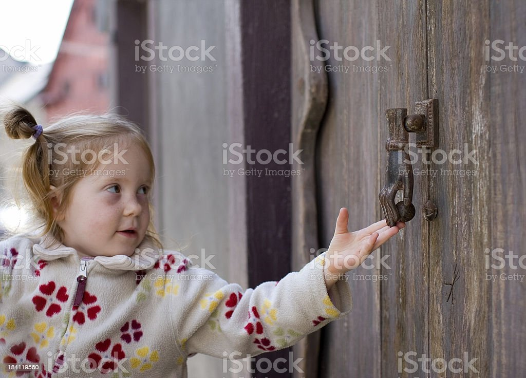 girl knocking on a door royalty-free stock photo