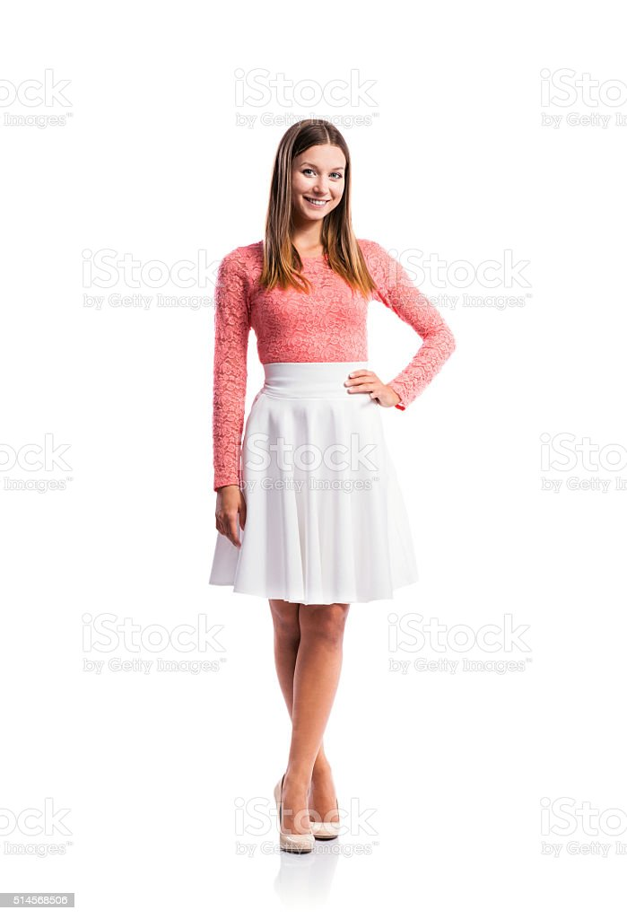 Girl, lace top, white skirt, heels, studio shot, isolated stock photo