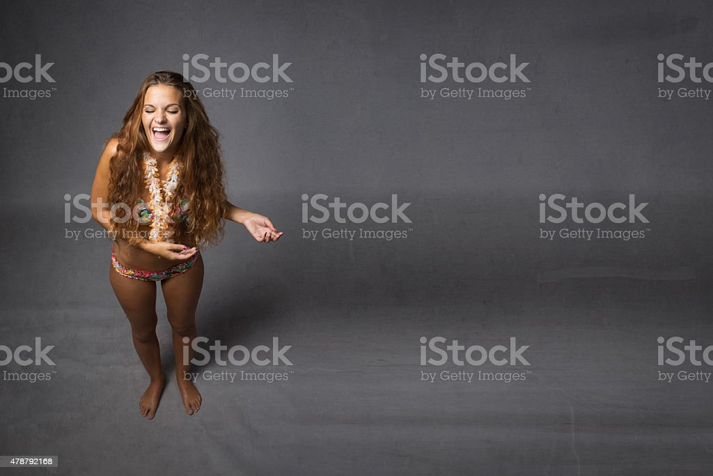 girl laughing in beachwear stock photo