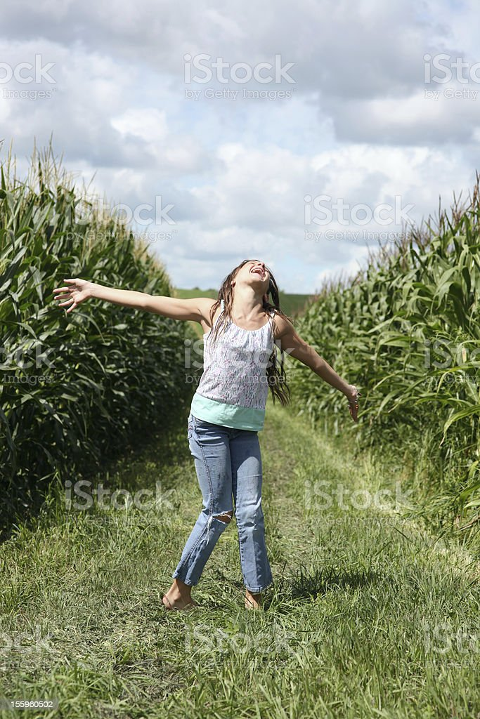 Girl laughing in the sun royalty-free stock photo