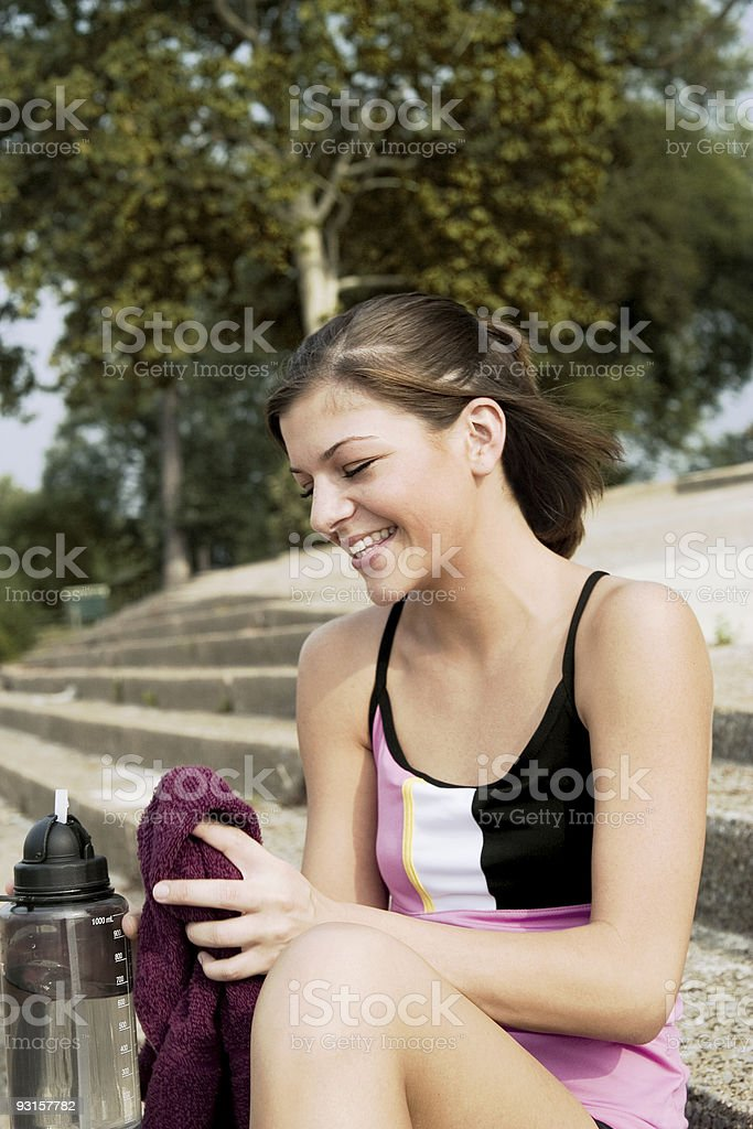 Girl Laughing on steps stock photo