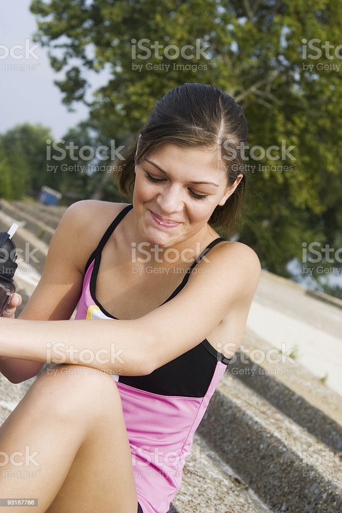 Girl laughing while drinking stock photo