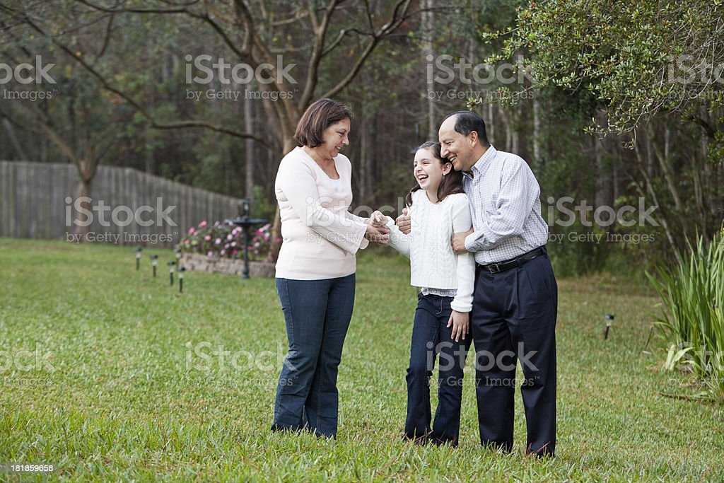 Girl laughing with grandparents stock photo