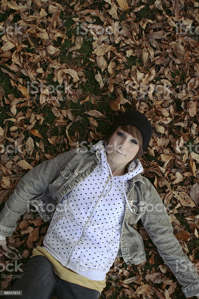 Girl Laying in Leaves stock photo