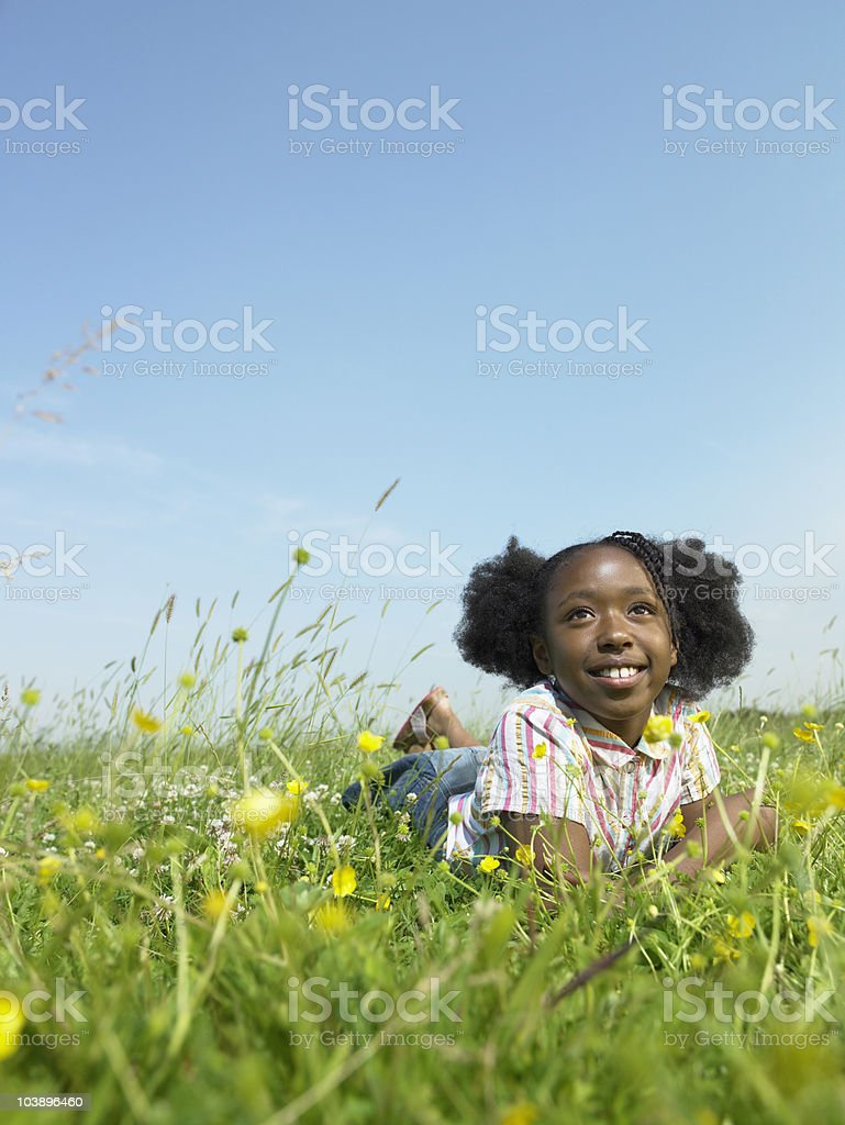 Girl laying in open field royalty-free stock photo