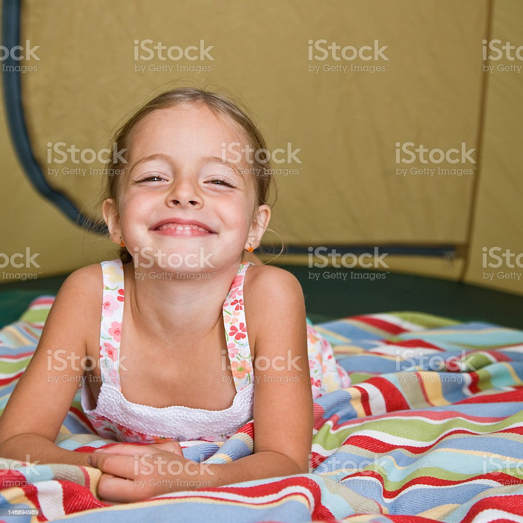 Girl Laying in Tent stock photo