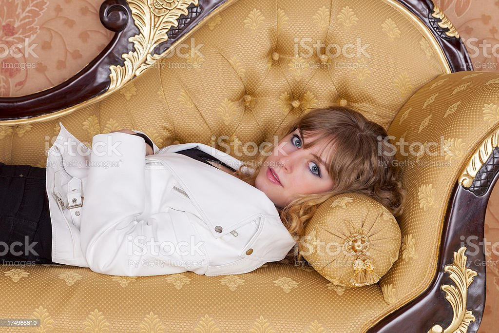 Girl Laying On A Chaise Longue royalty-free stock photo