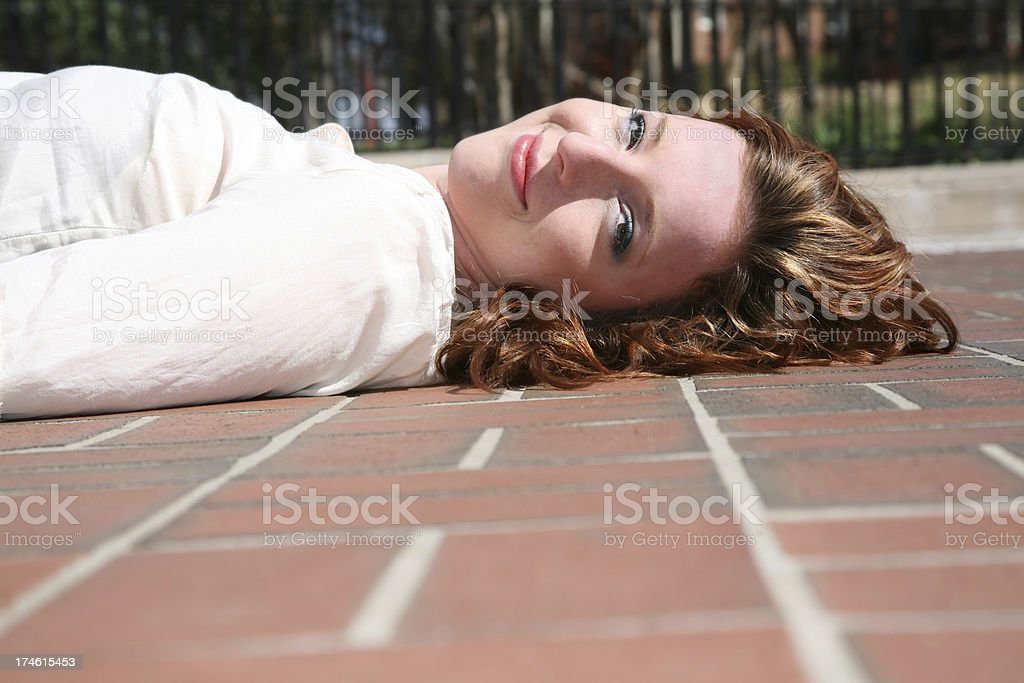 Girl Laying on the Ground royalty-free stock photo