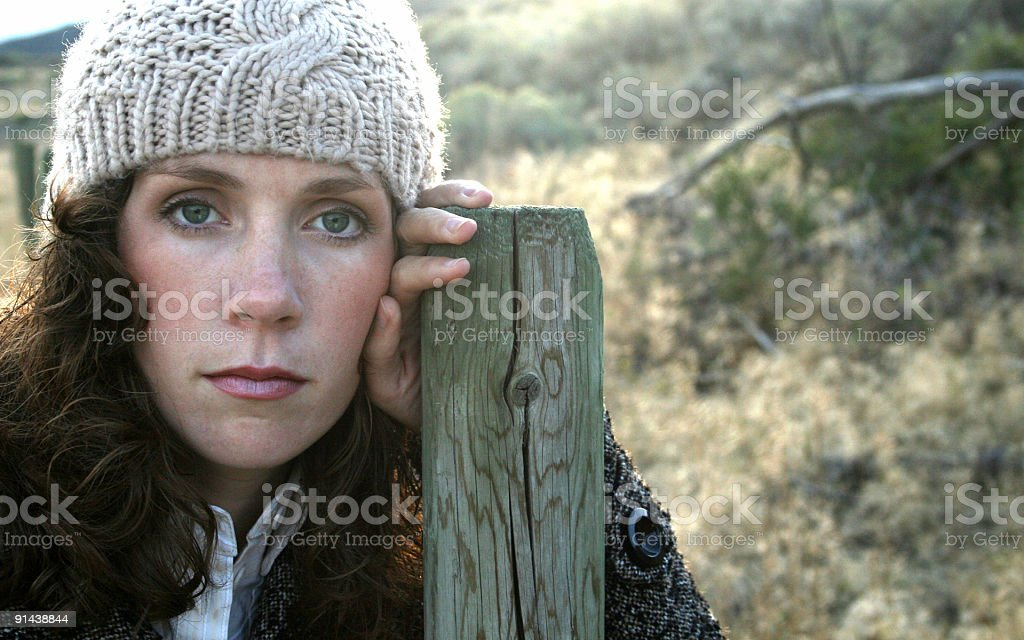 Girl Leaning on Post stock photo
