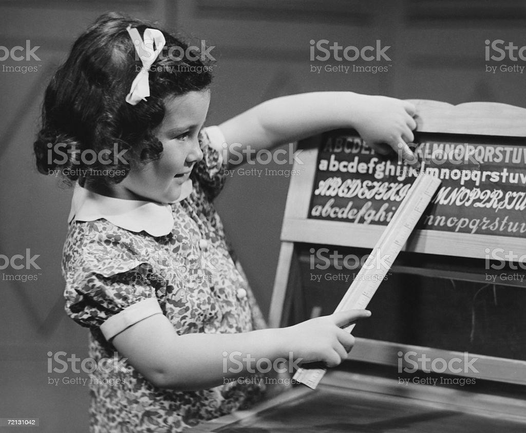 Girl (4-5) learning alphabet (B&W) royalty-free stock photo