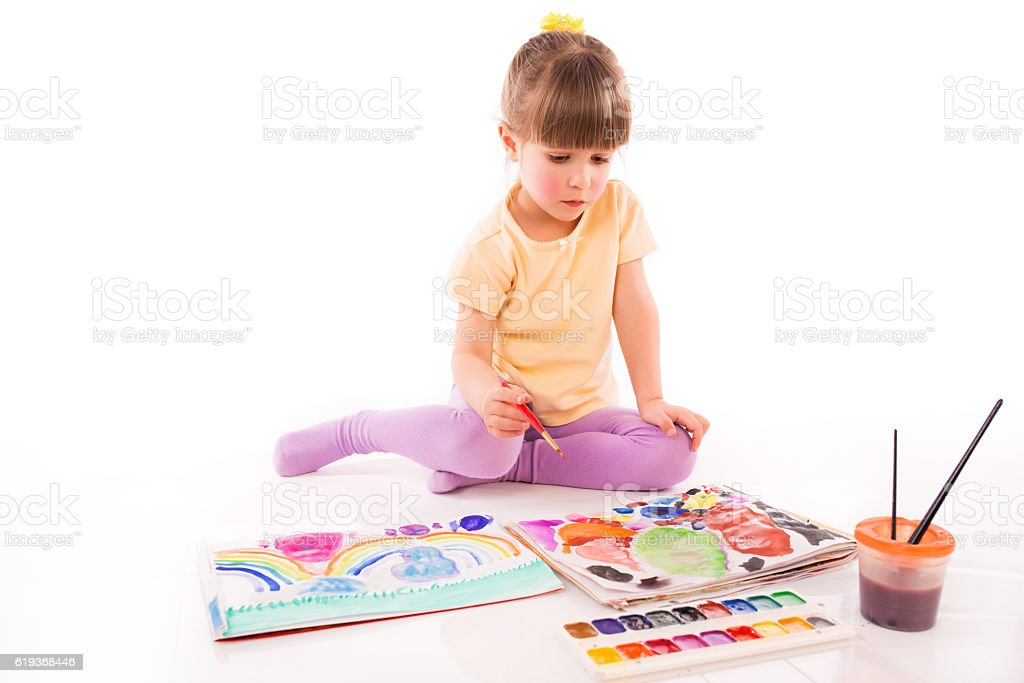 Girl Learning to Draw stock photo