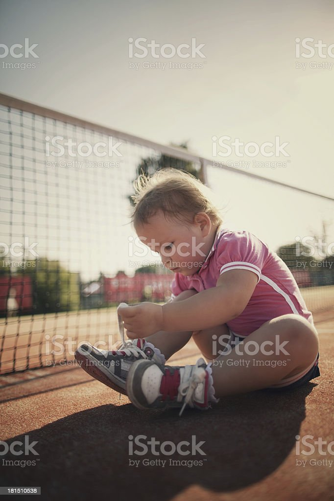 girl learning to tie shoelaces royalty-free stock photo