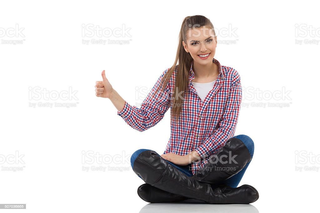Girl Legs Crossed Showing Thumb Up stock photo