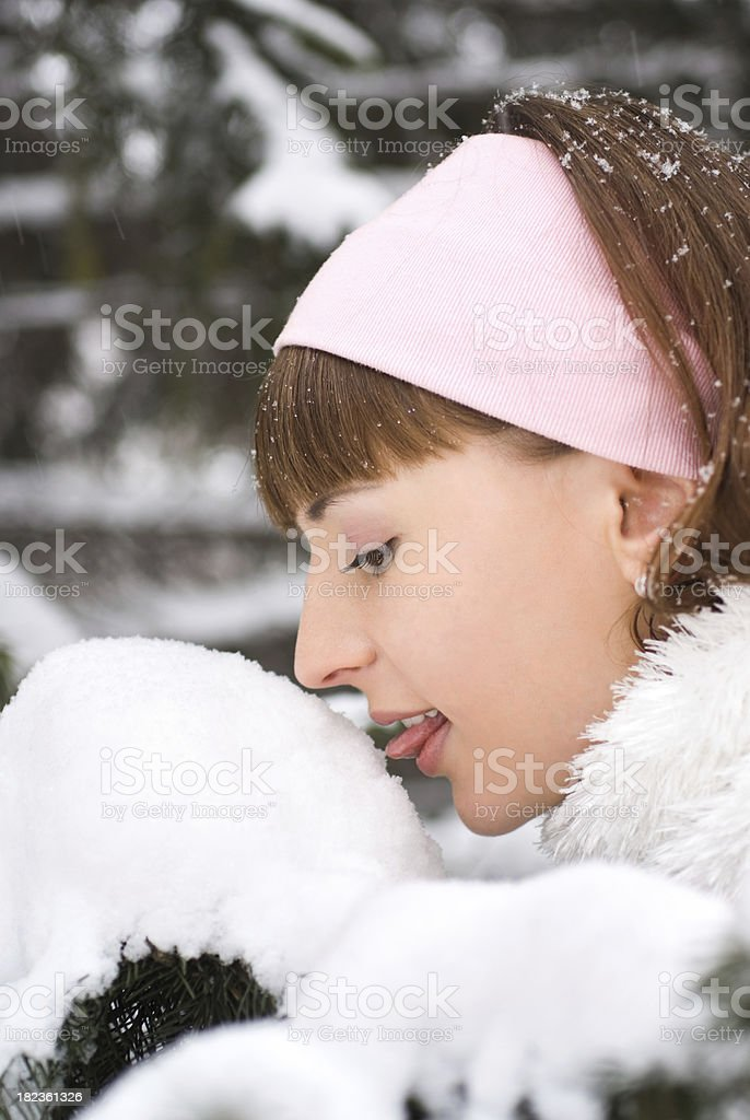 Girl licking snow close-up portrait royalty-free stock photo