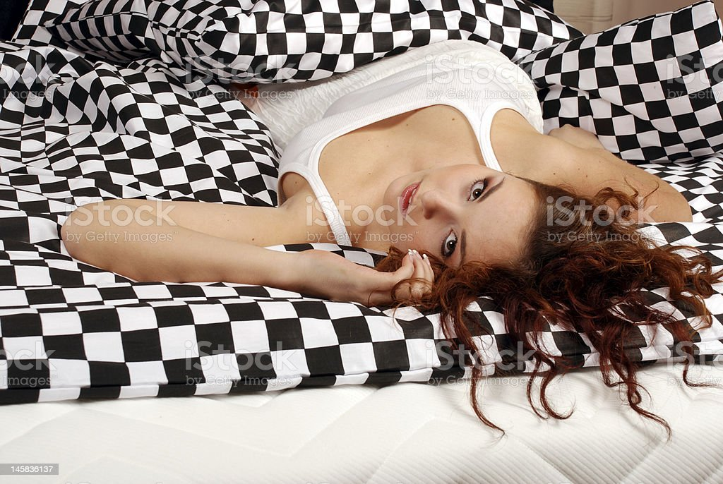 Girl lies in bed royalty-free stock photo