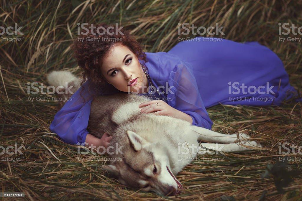 Girl lies on a dead dog. stock photo