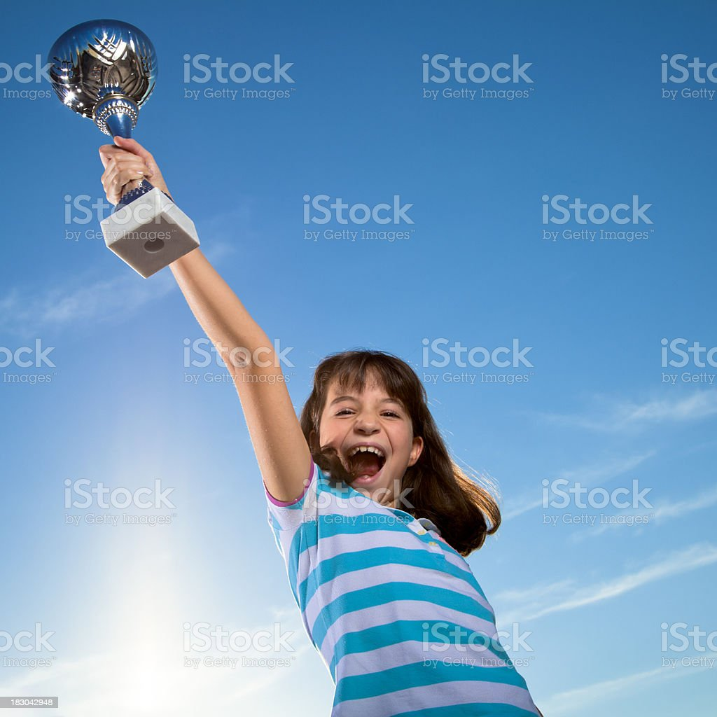 Girl lifting a trophy royalty-free stock photo
