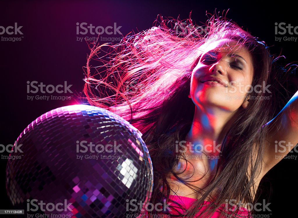 Girl listening music and dancing with disco ball stock photo