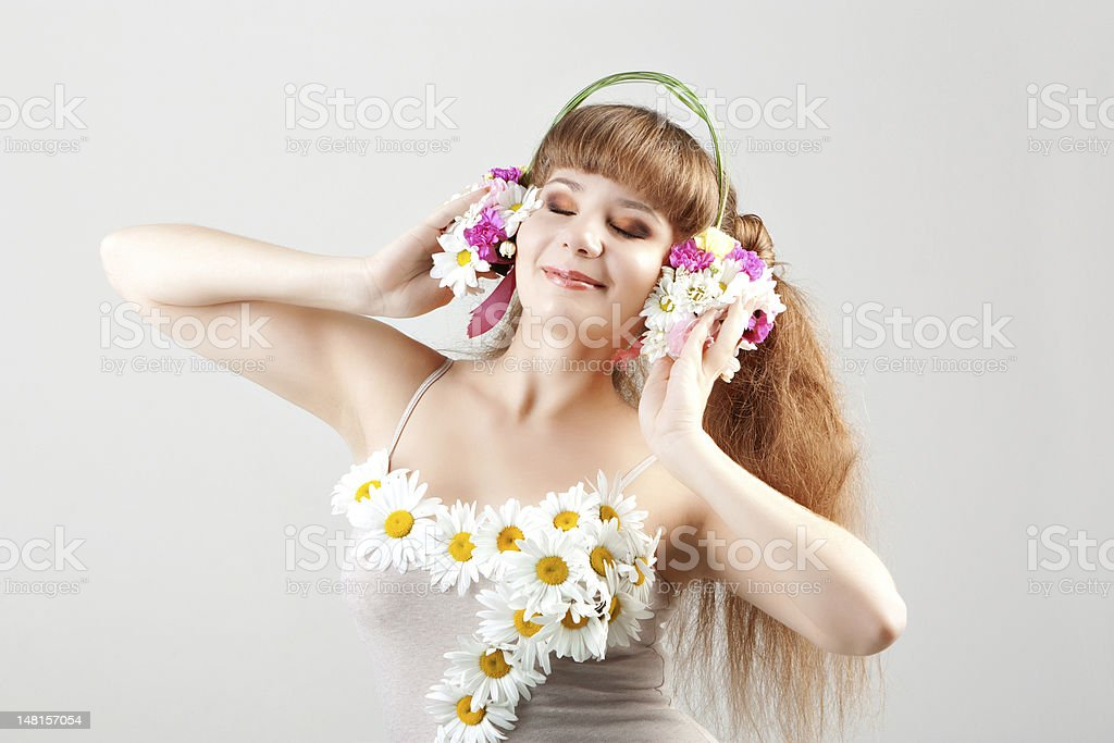 girl listening music in headphones of flowers royalty-free stock photo