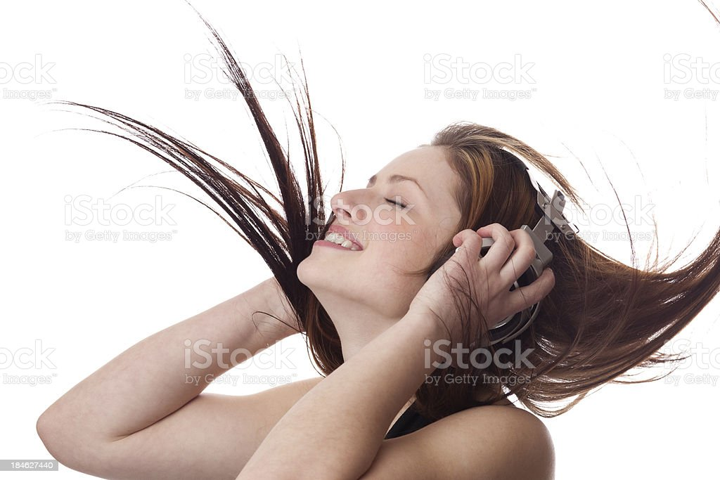 Girl listening music with Headphones on white background stock photo