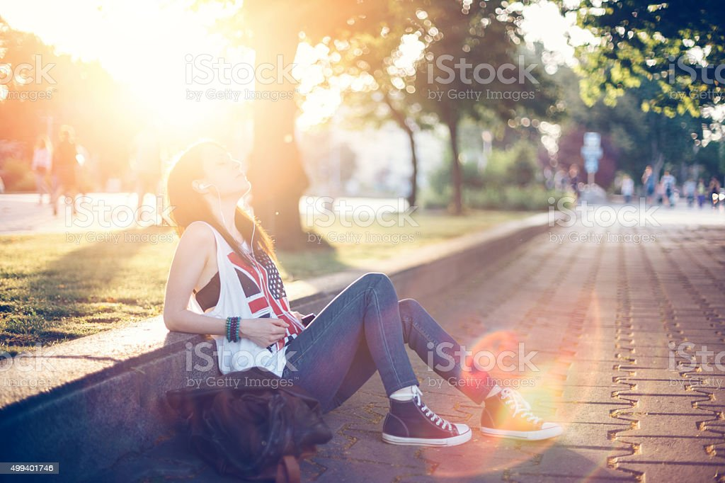 Girl listening to the music stock photo