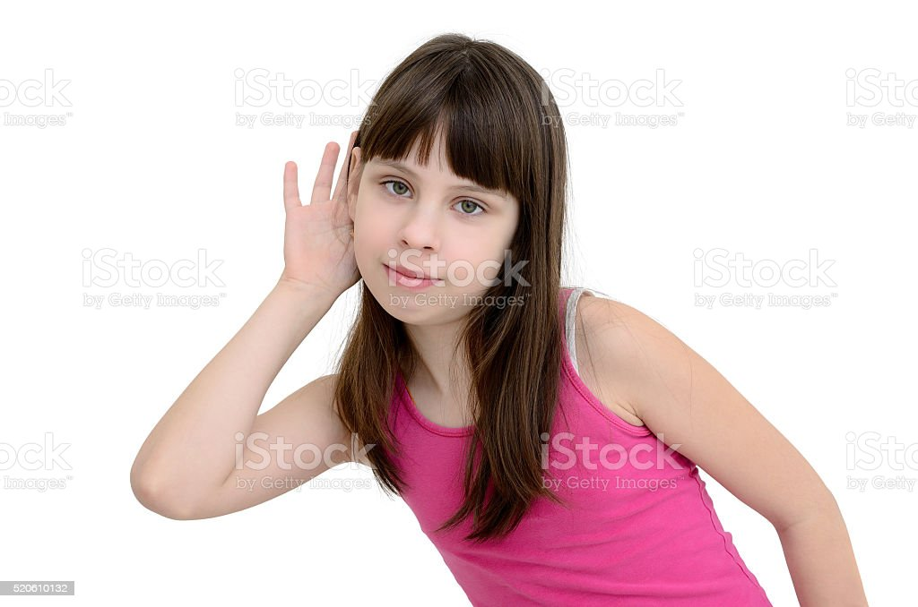 Girl listens isolated on a white background stock photo