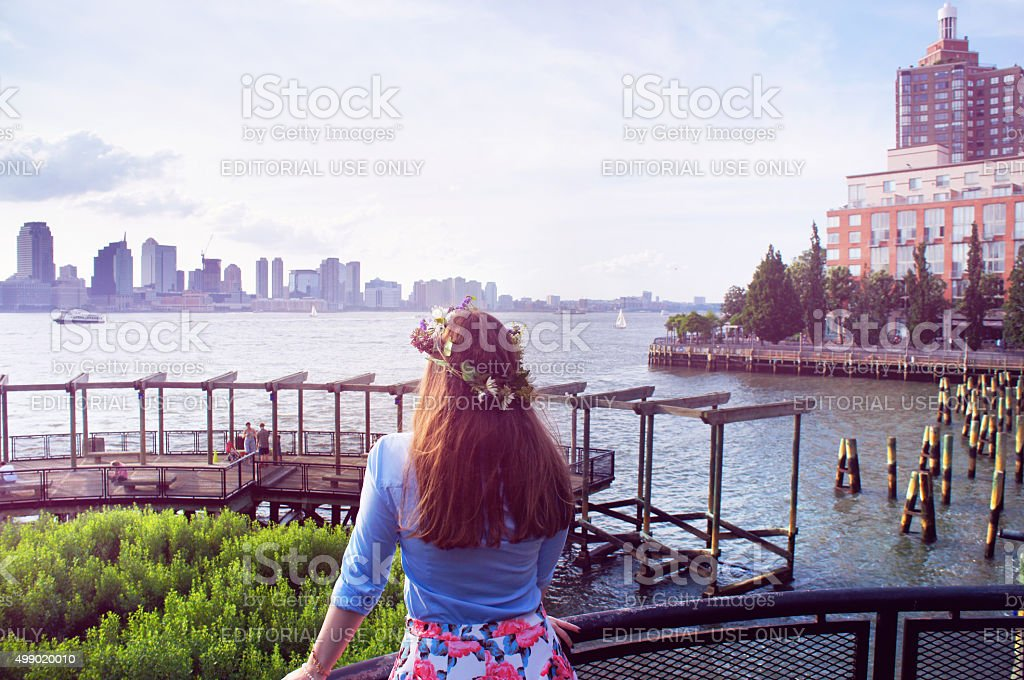 Girl look at Manhattan and Jersey City buildings panorama stock photo