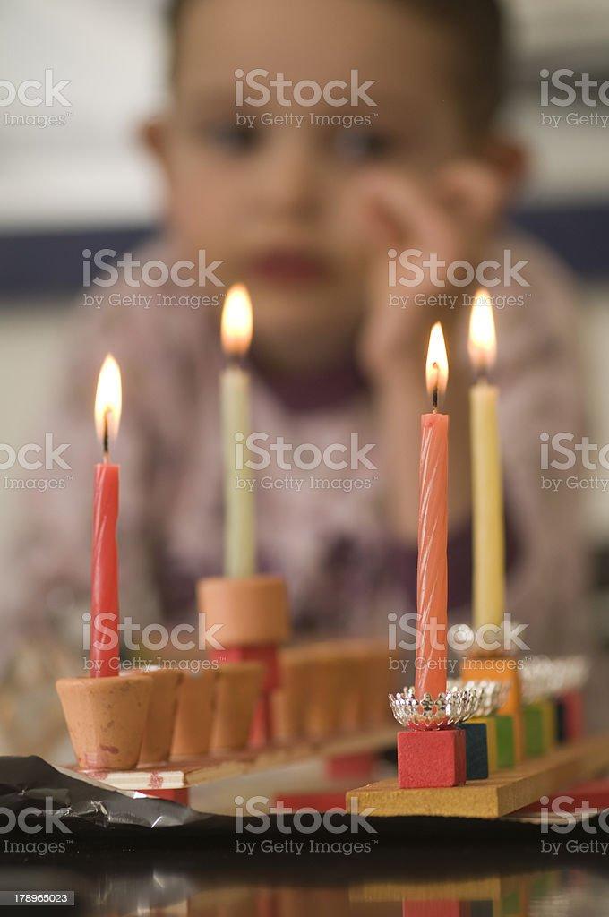 girl look at the Hanukkah menorah royalty-free stock photo