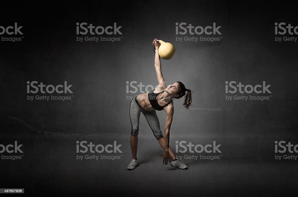 girl looking a kettlebell stock photo