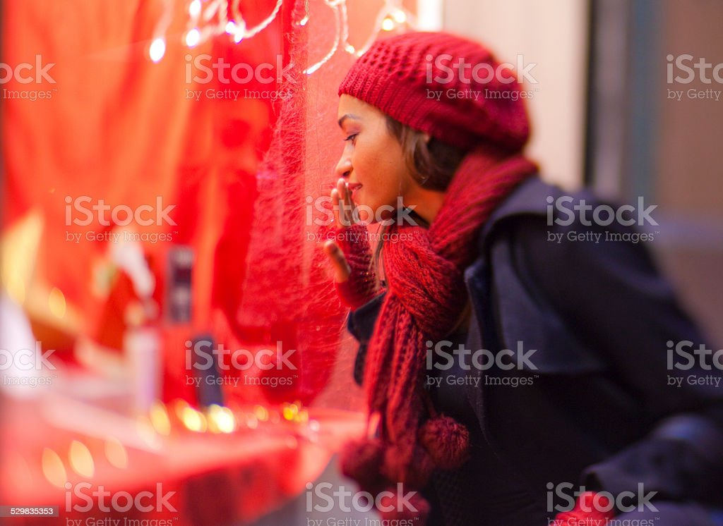 Girl looking a shop stock photo